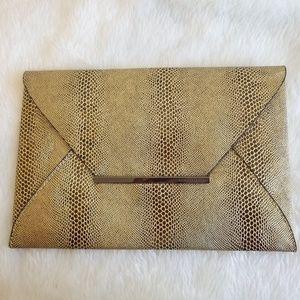 Bcbgmaxazria gold envelope clutch